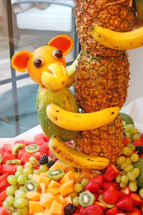 Pineapple Tree Centerpiece with Fruit Monkeys, for a luau party - from @Glorious Treats: